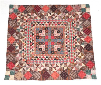 Lot 2024 - A 19th Century Reversible Patchwork Quilt, incorporating vibrant patches of mainly floral...