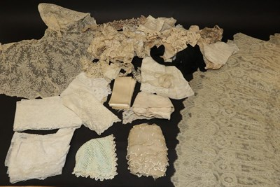 Lot 2031 - A Late 19th Century/Early 20th Century Cream Lace Cape, of decorative floral design with a...