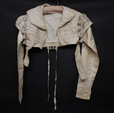 Lot 2049 - An Early 19th Century Regency Cream Figured Silk Wedding Jacket, woven with clovers, decorated with