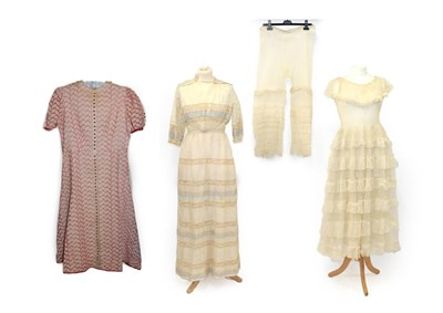 Lot 2060 - Late 19th Early 20th Century Ladies' Costume, comprising a cream net sleeveless dress with a double
