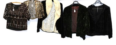 Lot 2063 - Circa 1920s Ladies' Evening Wear, comprising a black velvet long sleeve jacket, with smocking...