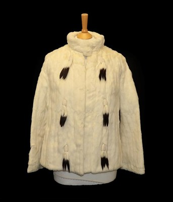 Lot 2064 - Circa 1950s J Bryer of Harrogate Ermine Evening Jacket, with long sleeves, collar and hung with...