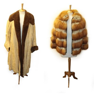 Lot 2070 - Revillon Red Fox Long Sleeved Jacket with zip fastening; and a Circa 1930s Cream Astracan Long...