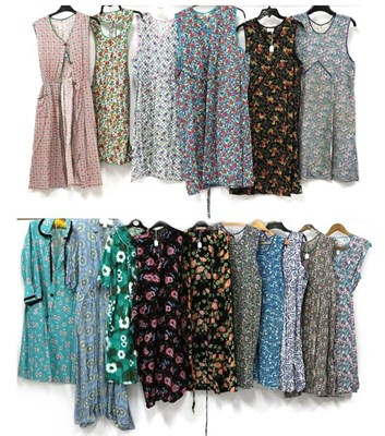 Lot 2093 - Thirteen Circa 1950s Printed Cotton Aprons of various designs, labels include Beech Tree,...
