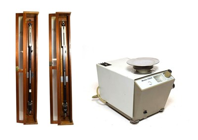 Lot 3064 - F D & Co (Watford) A Pair Of Laboratory Barometers both in wooden cases; together with a...