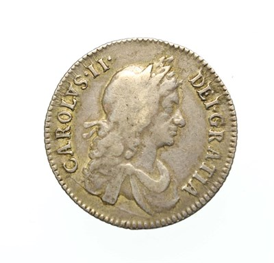 Lot 4009 - Charles II, 1668 Shilling. Obv: Second, laureate and draped bust right. Rev: Cruciform shields with