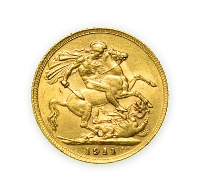 Lot 4089 - George V, 1911 Sovereign. Obv: Bare head of George V left, B.M. on truncation for engraver...