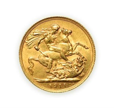 Lot 4090 - George V, 1911 Sovereign. Obv: Bare head of George V left, B.M. on truncation for designer...