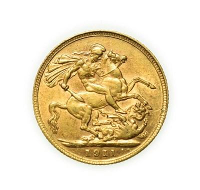 Lot 4091 - George V, 1911 Sovereign. Obv: Bare head of George V left, B.M. on truncation for designer...