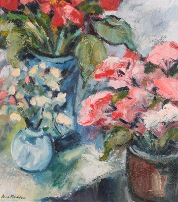 Lot 1054 - Anne Mendelow (b.1945) Study of red and white flowers in pots Signed, oil on canvas, 36.5cm by 32cm