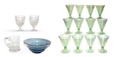 Lot 1 - A set of twelve Continental green cocktail glasses, of trumpet form and each raised on folded foot
