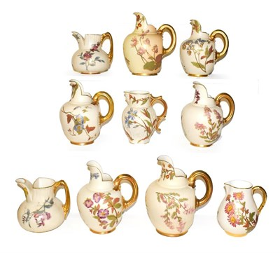 Lot 11 - Ten Royal Worcester blush ware jugs including Victorian, mostly flat back and also including a mask