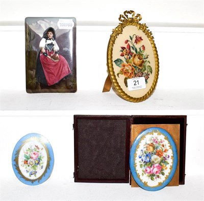 Lot 21 - A Serves style plaque in leather case painted with flowers and another similar, a KPM style...