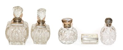 Lot 24 - Four George V cut glass scent bottles with silver mounts, together with a Victorian cut glass...