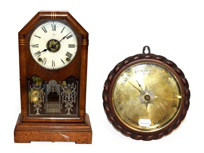 Lot 29 - A Seth Thomas mantel clock with alarm function, together with an oak cased wheel barometer with...