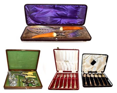 Lot 30 - A pair of Victorian cased silver plated fish servers with stained ivory handles, together with...
