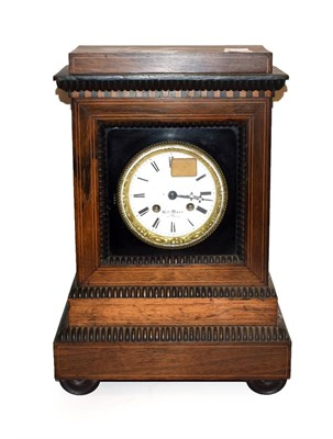 Lot 36 - A 19th century French inlaid rosewood striking mantel clock, with gilt bezel and enamel dial singed