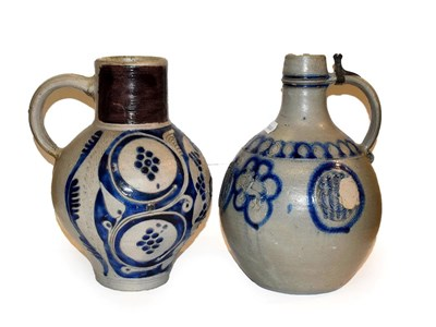 Lot 45 - Two 18th century German Westerwald salt glazed stoneware flagons, one with a Royal monogram GR, the