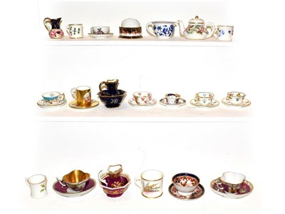 Lot 49 - A collection of porcelain miniatures to include a King Street Derby dolls house teapot and...