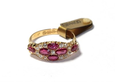 Lot 59 - An 18 carat gold synthetic ruby and diamond cluster ring, four oval cut synthetic rubies with...