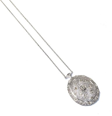 Lot 63 - A diamond pendant necklace, the white oval filigree pendant set throughout with round brilliant cut