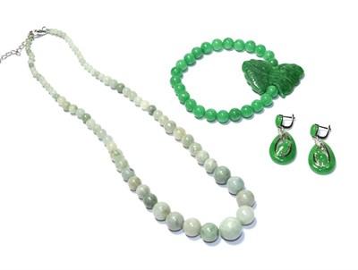 Lot 65 - A graduated jadeite necklace, clasp stamped '925', length 47cm, an elasticated jadeite bracelet and