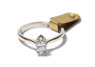 Lot 69 - A diamond solitaire ring, the marquise cut diamond in a white claw setting, to a tapered...