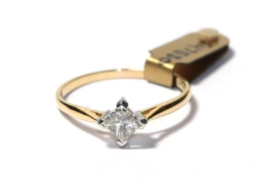 Lot 70 - A diamond solitaire ring, the princess cut diamond in a white four claw setting, to a yellow...