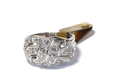 Lot 71 - A diamond cluster ring, of openwork scroll design, set throughout with round brilliant cut diamonds