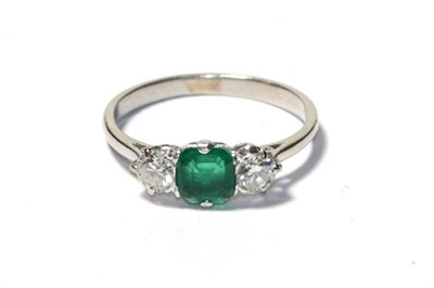 Lot 73 - An emerald and diamond three stone ring, the asscher cut emerald flanked by round brilliant cut...