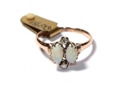 Lot 74 - An opal and diamond ring, the two oval cabochon opals with round brilliant cut diamond accents,...