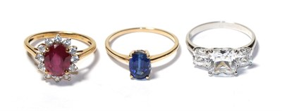Lot 75 - A 9 carat gold kyanite solitaire ring, finger size P1/2, a 14 carat white gold cubic zirconia three