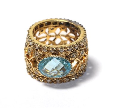 Lot 86 - A blue topaz and diamond ring, unmarked, finger size Q