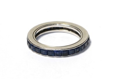 Lot 87 - A sapphire eternity ring, the calibré cut sapphires in a white channel setting, finger size I