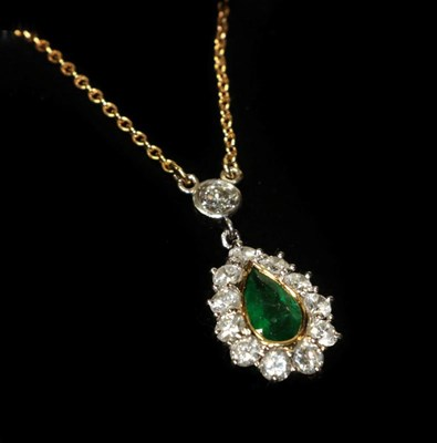 Lot 89 - An 18 carat gold emerald and diamond cluster necklace, the pear cut emerald in a yellow rubbed over