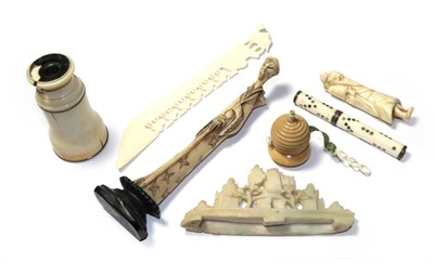 Lot 92 - A quantity of 19th century ivory and bone items including a beehive form tape measure,...