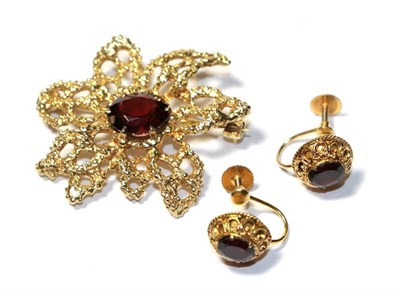 Lot 93 - A 9 carat gold garnet brooch, length 3.7cm and a pair of garnet earrings, stamped '9CT', with screw