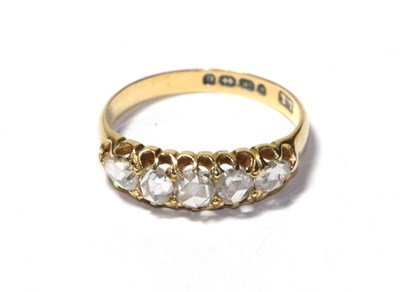 Lot 96 - An 18 carat gold diamond five stone ring, three rose cut diamonds flanked by pear shaped rose...
