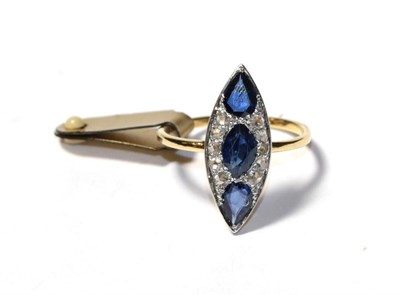 Lot 98 - A sapphire and diamond ring, the navette shape formed of an oval sapphire and two pear cut...