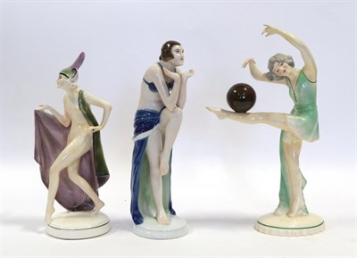 Lot 2038 - An Art Deco Katzhutte (Thuringia) Pottery Figure, modelled as a nude female wearing a cape and...