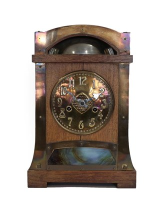 Lot 2059 - A German Arts & Crafts Oak and Brass Mantel Clock, probably retailed by Liberty & Co., the...