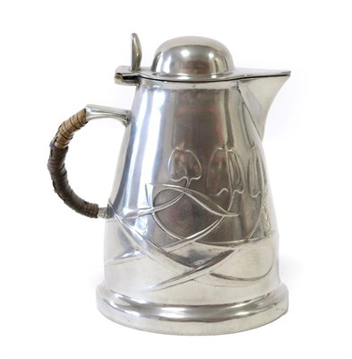 Lot 2063 - Liberty & Co: A Tudric Pewter Hot Water Jug, with a domed hinged cover, rattan covered handle, with