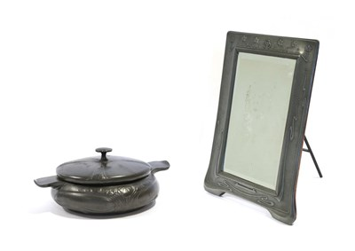 Lot 2075 - An Art Nouveau Pewter Easel Toilet Mirror, the top with three interlinking circles surrounded...