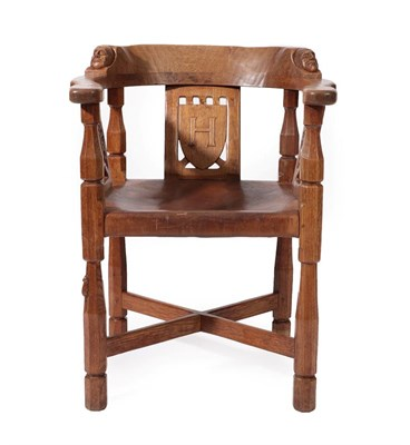 Lot 2087 - Robert Mouseman Thompson (1876-1955): An English Oak Monk's Chair, with curved back and shaped...