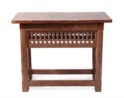 Lot 2088 - Robert Mouseman Thompson (1876-1955): An English Oak Communion Table, the dowelled two plank...