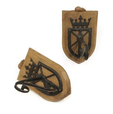 Lot 2090 - Robert Mouseman Thompson (1876-1955): A Pair of  English Oak Wall Brackets, the shield backs...