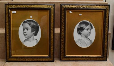 Lot 1049 - Style of George Richmond, portrait of a young boy, head and shoulders, black and white print,...