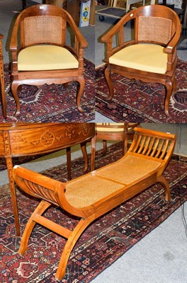 Lot 1063 - A pair of modern teak tub chairs with cane work panel 60cm by 56cm, 88cm high, seats 44cm high,...