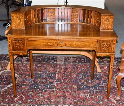 Lot 1064 - An American mahogany Carlton House style desk, with marquetry inlay, fitted superstructure and...