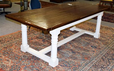 Lot 1065 - A modern oak farmhouse dining table, pegged plank top with painted base, Peter Thompson of...